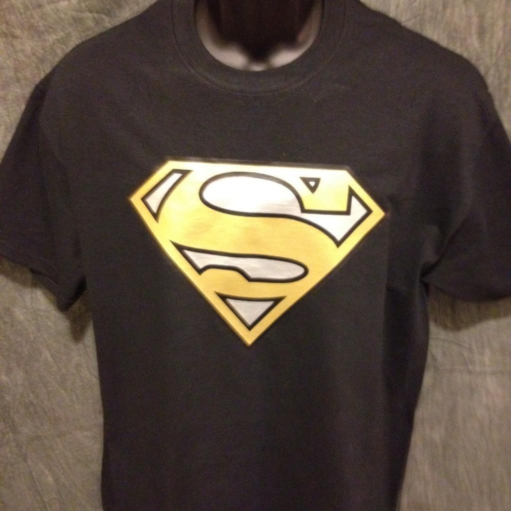 Superman logo variant gold and silver alternate color black